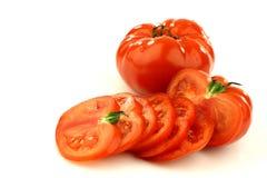 nötkött en hel skivad tomat Arkivfoto