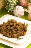 nötkött huggen av stekt lever Arkivfoto