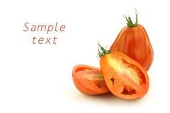 nötkött klippt ny en tomat Arkivfoton