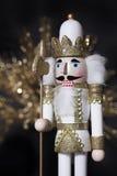 Nötknäppare för vit guld för jul Arkivfoton
