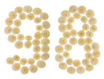Número árabe 98, noventa y ocho, de las flores poner crema del chrysanth Fotos de archivo libres de regalías