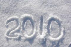 Número 2010 escrito na neve de brilho Imagem de Stock Royalty Free