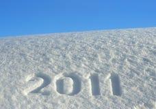 Número 2011 en la nieve acumulada por la ventisca Foto de archivo libre de regalías
