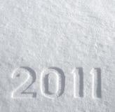 Número 2011 en nieve que brilla Fotos de archivo