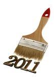 Número 2011 y cepillo Imagenes de archivo