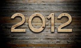 número 2012 en el fondo de madera Fotografía de archivo
