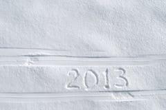 Número 2013 en nieve Imágenes de archivo libres de regalías