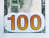 Número 100 Cem da conta dólares de closw-up do fragmento, edição nova Foto de Stock