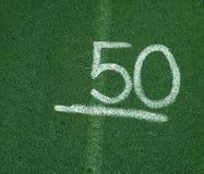 Número 50 cinqüênta no fundo verde Imagem de Stock