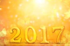Número 2017 colocado no fundo elegante do encanto do ouro para o YE novo Fotografia de Stock Royalty Free