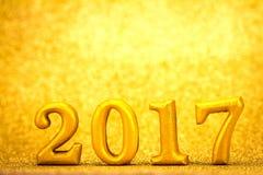 Número 2017 colocado no fundo elegante do encanto do ouro para o YE novo Imagens de Stock