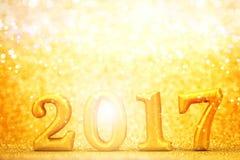 Número 2017 colocado no fundo elegante do encanto do ouro para o YE novo Foto de Stock Royalty Free