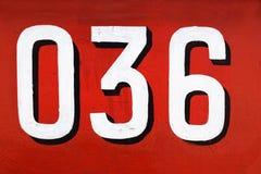 Número 036 contra o fundo vermelho Fotos de Stock Royalty Free