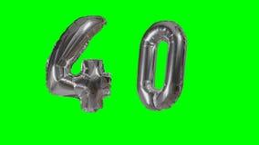 Número 40 cuarenta años del cumpleaños del aniversario de globo de la plata que flota en la pantalla verde - almacen de video