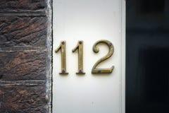 Número da casa 112 fotografia de stock