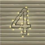 Número 4 da festão da luz de Natal em um fundo de madeira bonito Imagens de Stock Royalty Free