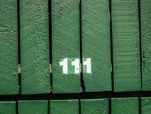 Número da rua, 111 no fundo de madeira Fotografia de Stock