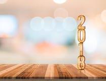 número da textura da madeira 2018 no tampo da mesa de madeira da prancha com resumo do borrão Fotos de Stock