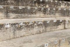 Número de assento marcado na arena em Arles fotografia de stock royalty free