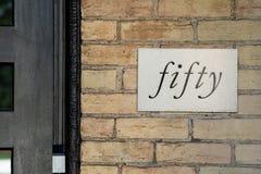 Número de casa creativo cincuenta imagen de archivo