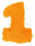 Número de lentejas amarillas en un fondo blanco Imágenes de archivo libres de regalías