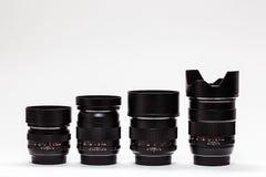 Número de lentes caras na fileira Fotos de Stock