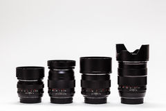 Número de lentes costosas en fila Fotos de archivo