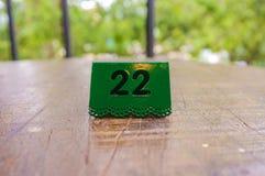 Número de matrícula en tabla Imagen de archivo