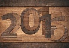 número del Año Nuevo 2016 escrito en fondo de madera Fotografía de archivo libre de regalías