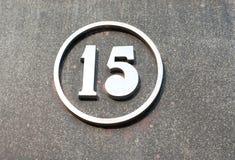 Número del metal en la pared Fotografía de archivo