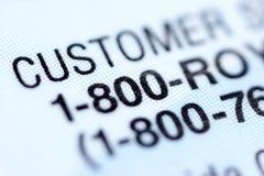 Número del servicio de atención al cliente. Fotografía de archivo