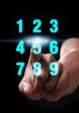 Número del tecleo de la mano Imagenes de archivo