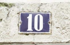 Número diez en una pared Foto de archivo libre de regalías