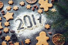 Número do ano novo feliz 2017 escrito na farinha Fotografia de Stock Royalty Free