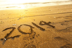Número do ano novo 2014 na areia Foto de Stock