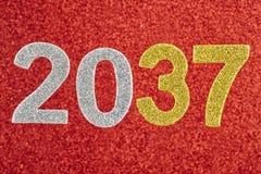 Número dois mil e trinta e sete sobre um fundo vermelho anni Imagem de Stock