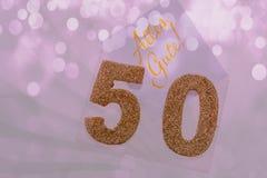 Número dourado 50 na tampa com texto alemão todo o melhor Imagem de Stock Royalty Free