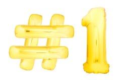 Número dourado um com símbolo do hashtag Foto de Stock