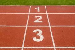 1 número 2 3 en circuito de carreras en estadio de fútbol Imagen de archivo