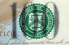 Número 100 en el billete de dólar 100 Foto de archivo libre de regalías