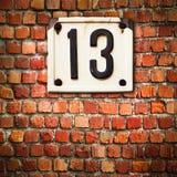 Número 13 en fondo de la pared Fotografía de archivo libre de regalías
