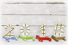 Número 2015 en los trineos pintados Imagen de archivo libre de regalías