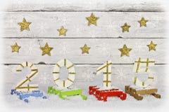 Número 2015 en los trineos pintados Imágenes de archivo libres de regalías