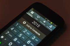 Número 2015 en una pantalla del smartphone Fotografía de archivo libre de regalías