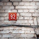 Número 92 en una pared Fotos de archivo