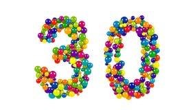 Número 30 formado de bolas decorativas del arco iris Imágenes de archivo libres de regalías
