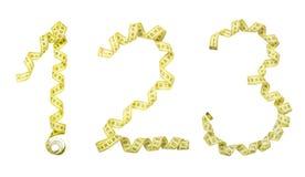Número hecho de la cinta amarilla del centímetro Aislado, dos, thre Imágenes de archivo libres de regalías