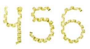 Número hecho de la cinta amarilla del centímetro Cuatro aislados, cinco, si Fotos de archivo libres de regalías