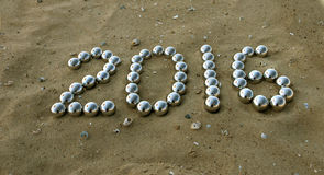 Número 2016 na areia Fotos de Stock