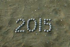 Número 2015 na areia Foto de Stock